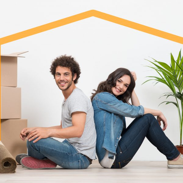 29864038 - smiling young couple sitting back to back after moving house